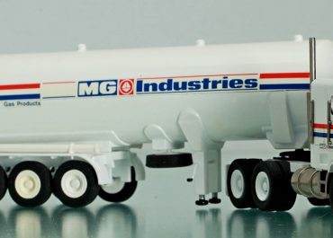 White Freightliner FLA 9664T Powerliner «MG Industries» truck tractor with 3-axle semi-trailer-tank TT 300